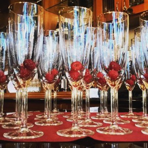 champagne flutes with raspberries